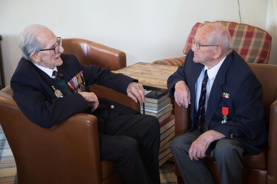 """Two D-Day veterans, Ted Owens and Tony Bird, sit talking at """"Our Greatest Generation,"""" an Age Cymru Dyfed event commemorating the 77th anniversary of D-Day. June 6th, 2021."""
