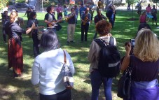 crowd thoroughly enjoying Turbo Street Funk, as they wrap up their portion of the walk in Fred Hamilton Park