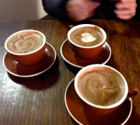 Delicious, spicy Mayan chocolate at Soma. Julie reaches for a cup, in anticipation!