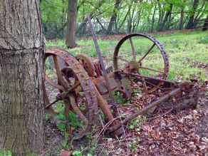 rusty old farm equipment in one of the small fields