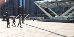Skylar, Jan & Len pass The Archer in Nathan .Phillips Square