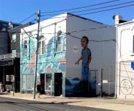 "Aquarium-like front mural by Olivier Bonnard, beside an 2015 neighbourhood favourite, ""Hello?"" by Hebru Brantley"