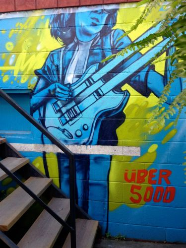 Jimmy Page by Uber 5000 - part of the series of murals on the tiny patio of the downtown Portland Street Jimmy's we did visit. Lovely cool shade there!