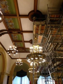 The current chamber repairs include work on the large light fixtures and the decorative ceiling around them.