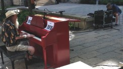 """A """"Play Me"""" piano in front of the Conservatory attracted a great ragtime player!"""