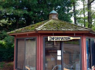 I was amused that this little dockside info booth is a pre-fab. And also at the hand-made paddle sign. And the moss (lots of it!) growing on the roof. I wonder if there are ever bats in that belfry? ;-)