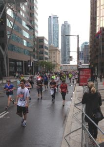 Near the end of the marathon, runners still stream (or straggle, in fatigue) up Bay Street, successful in their fund-raising mission. And personal challenge.