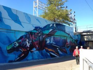 Sharon, Sally, Julie and Anna pass the fish mural (by Young Jarus and Kwest, part of Love Letter to the Great Lakes).