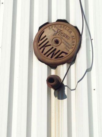Rusty old fire/sprinkler alarm.