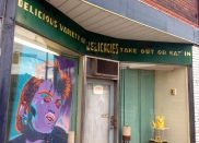 great vintage sign and funky modern art in a storefront