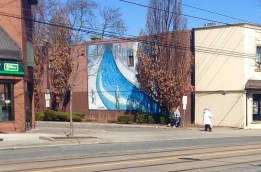 North side mural on Lakeshore shows the street as a river (painting by M. Hansen)