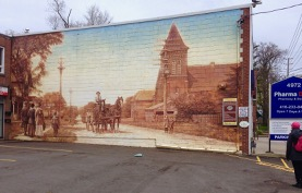 Laurie at Islington Village murals, John Kuna