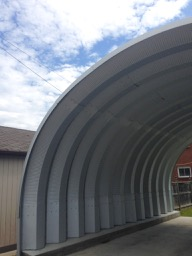 Art Lives Here Lane - very tall quonset hut as car port, and glorious sky!