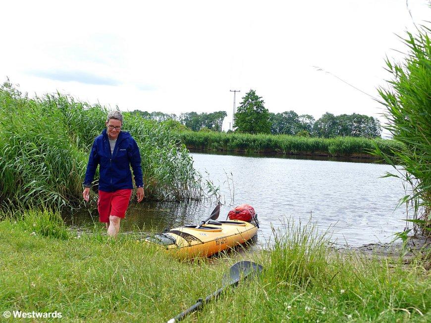 Yellow kayak on the river Peene
