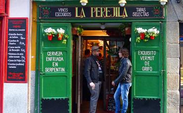 Two men standing at the entrance to a Tapas bar