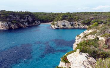 Turquoise blue water with white rocks