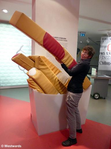Natascha with giant pommes frittes at Berlin Currywurst museum