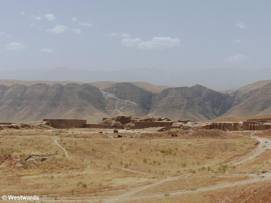 Ruins of Old Nisa with mountains in the background