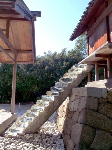 glass stairs leading up to a shrine on Naoshima Art Island