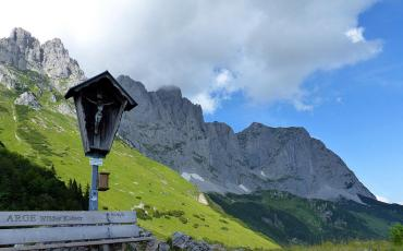 Crucifix and bench in the Tyrolean alps