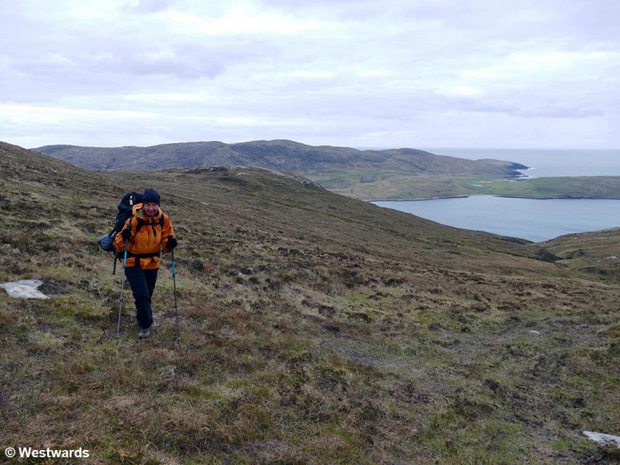 Woman in orange jacket hiking the Hebridean Way