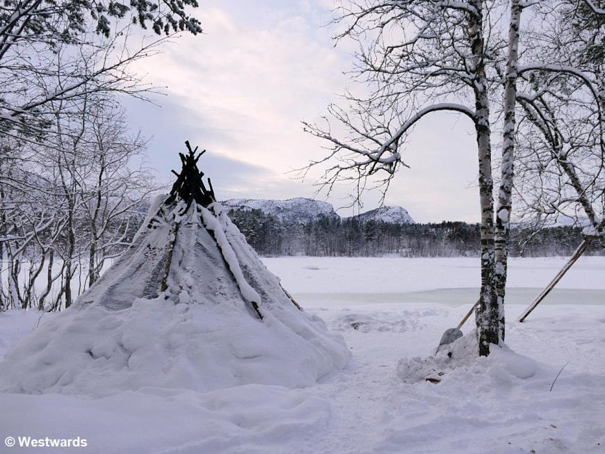 Sami tent in snowy landscape in Alta