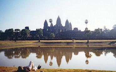 Natascha relaxing at a lake in front of Angkor Wat, no other tourists, in 2001