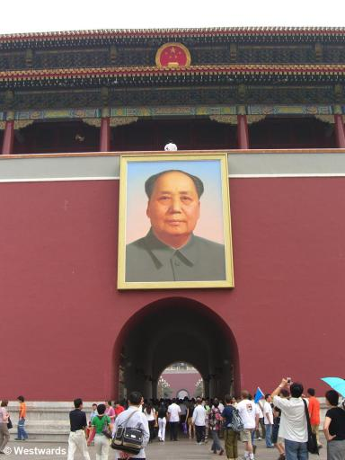 Visitors streaming into the Forbidden City below a Mao portrait