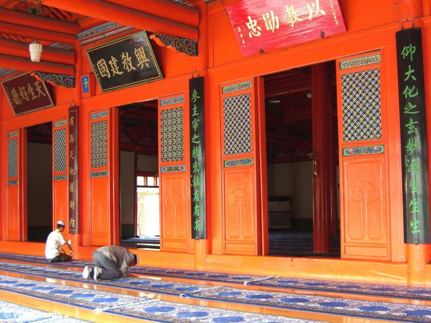 Men praying in a mosque in Xining that looks like a Chinese temple