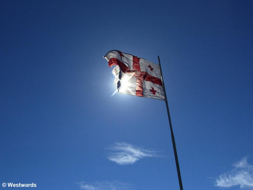 Georgian flag in blue sky
