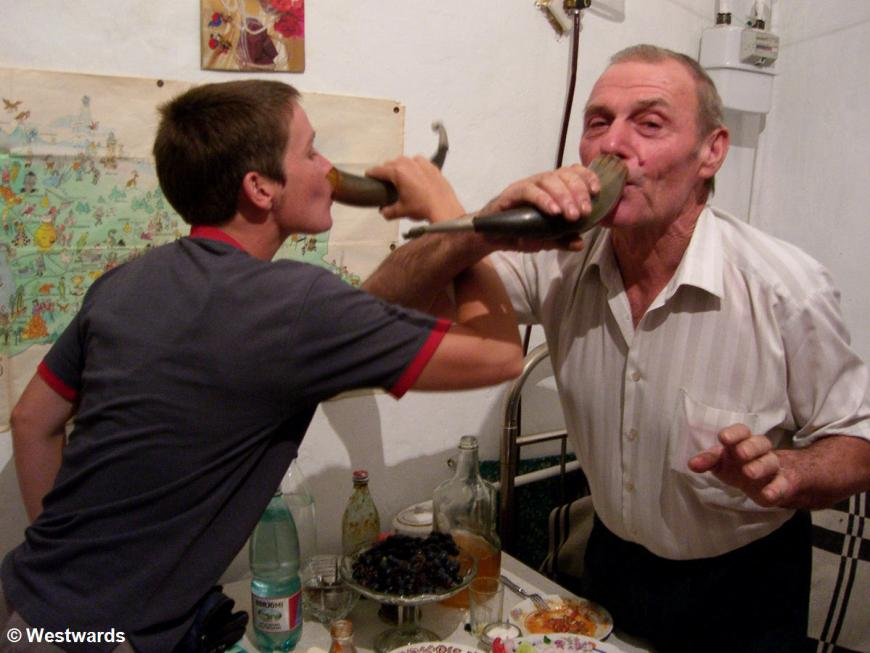 Isa drinking with a Georgian host