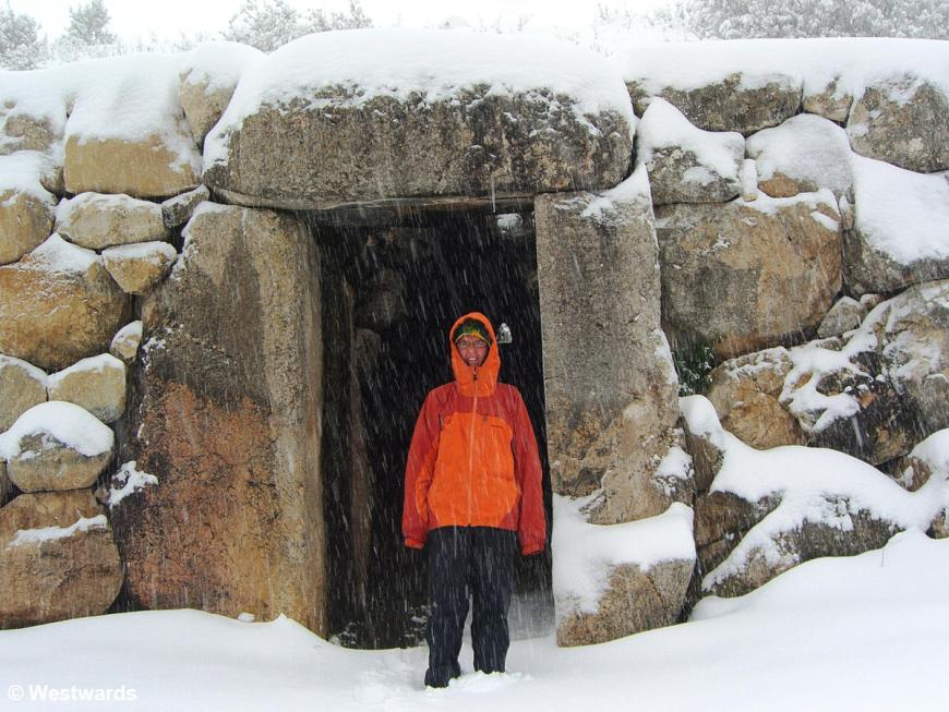 Natascha in raingear at the gate of the Sphinxes in Hattusha with much snow