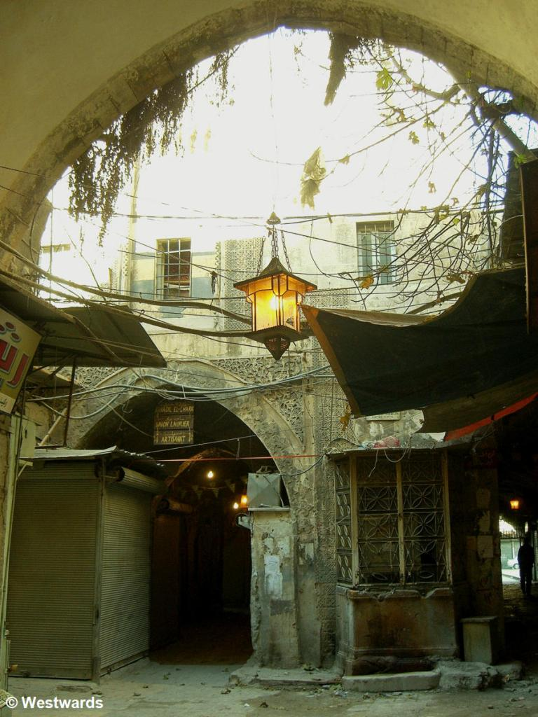 Arch and lamp in the Old town of Aleppo