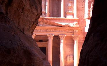 View through the rocks on the pink temple Al-Khazneh in Petra