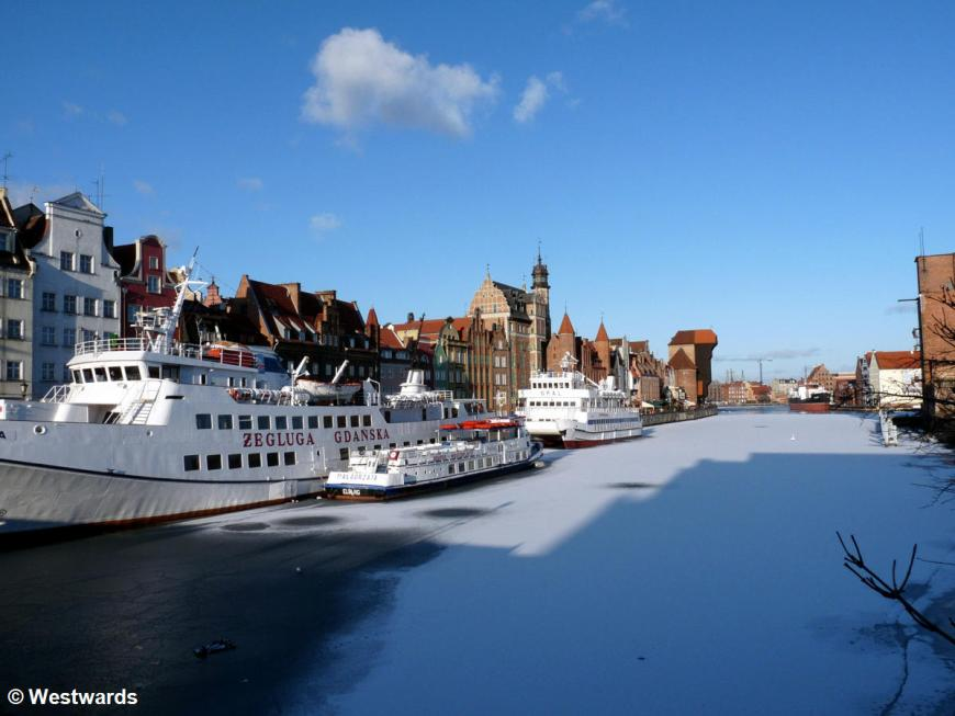 frozen canal with ships and houses in Gdansk