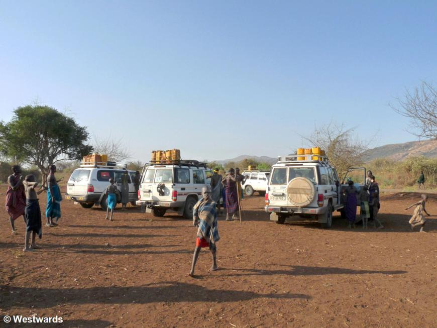 tourists visiting a Mursi village in the Omo valley