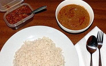 Plate of rice with chilli and soup