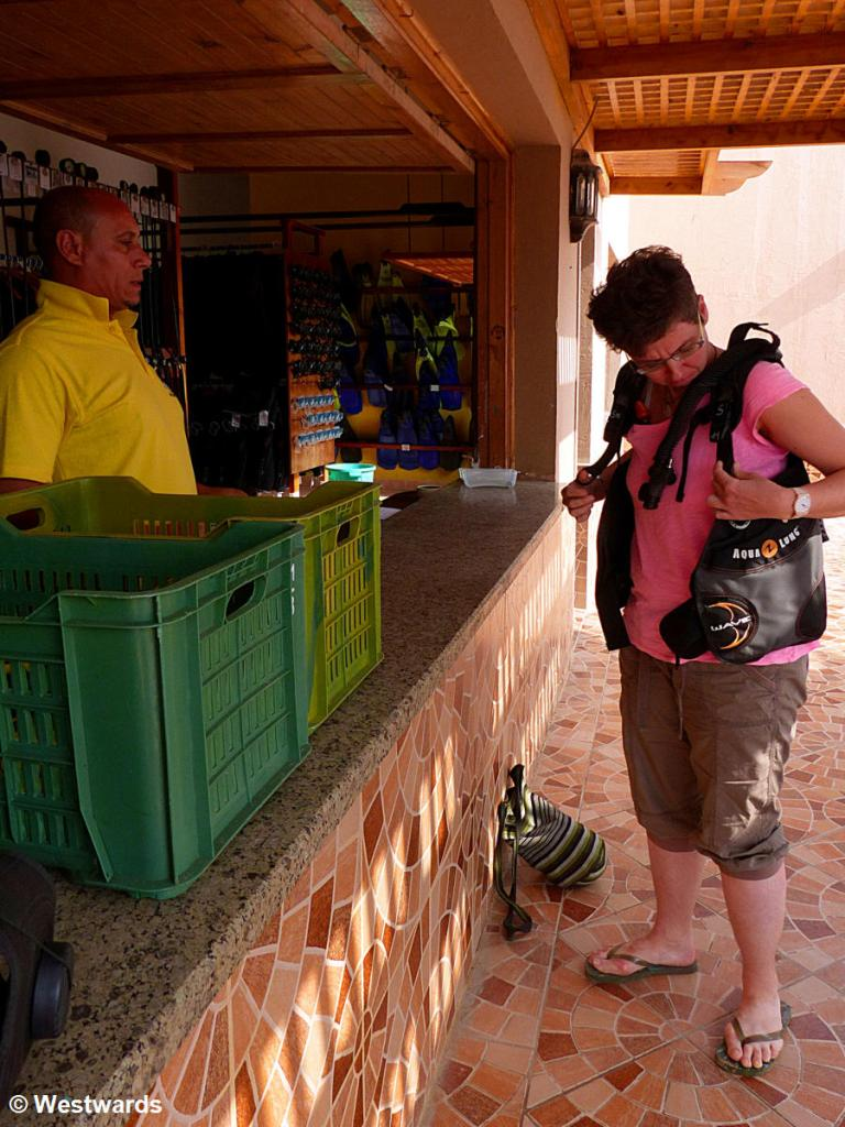 Natascha trying on diving gear in Soma Bay