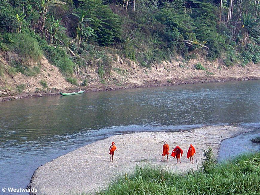 Monks after bathing in the river near Luang Prabang, Laos