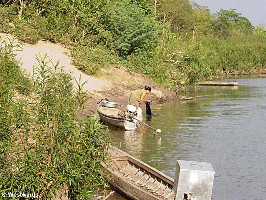 Woman washing clothes in the Mekong in Laos