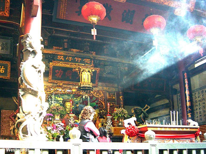 People praying in the temple of Matsu in Tainan