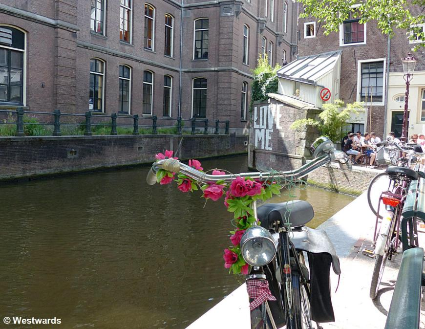 Bicycle in front of an Amsterdam town canal