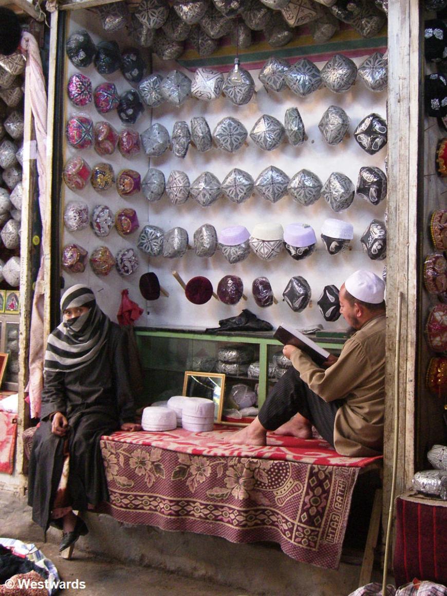 Market stall selling Uighur caps
