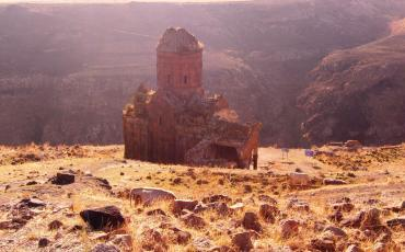 Ani in early morning light: the Church of St.Gregory with the ravine in the background