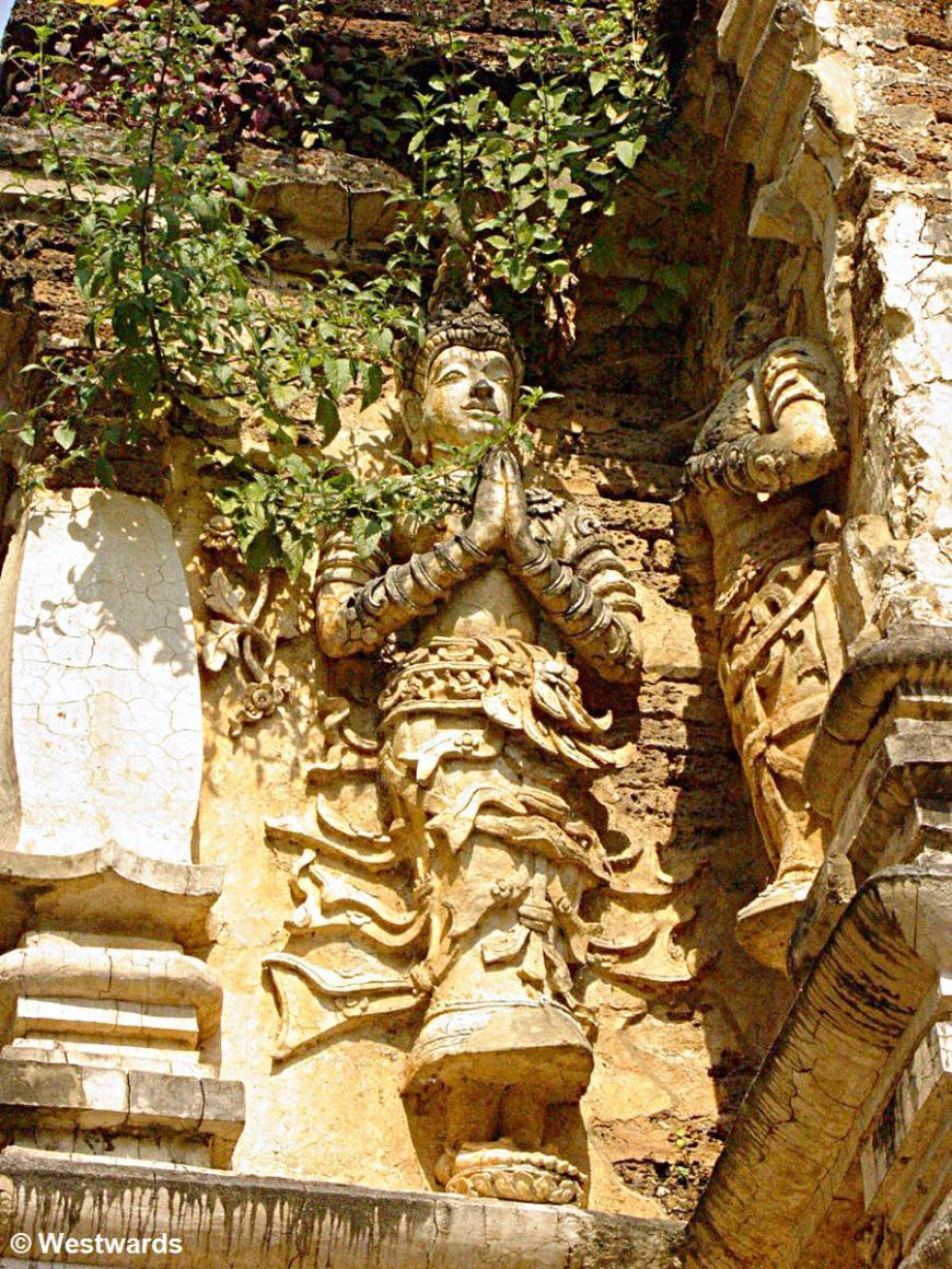 overgrown sculptures in Wat Jet Yot temple, Chiang Mai