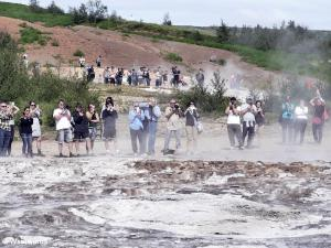 Many tourists photographing a Geysir in Iceland