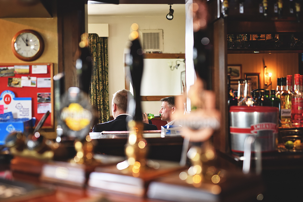 Groom having a beer at The Wagon & Horses before heading to Sandhole Oak Barn Wedding Venue
