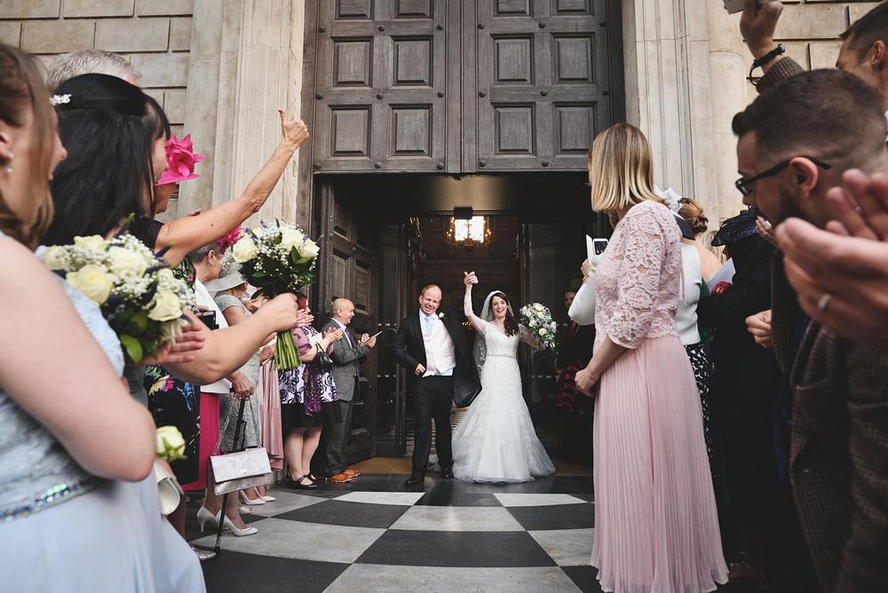 St Paul's Wedding Photographer - Wedding couple exiting St Paul's
