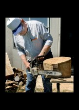 A chain saw is used to cut away excess wood around the circle to give the bowl its basic shape.