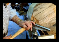 After mounting the log a lathe in his workshop, bowl maker Wes Kolkmeier of St. Charles chips away at the spinning log with a 1/2-inch gouge to rough out the shape of the bowl.